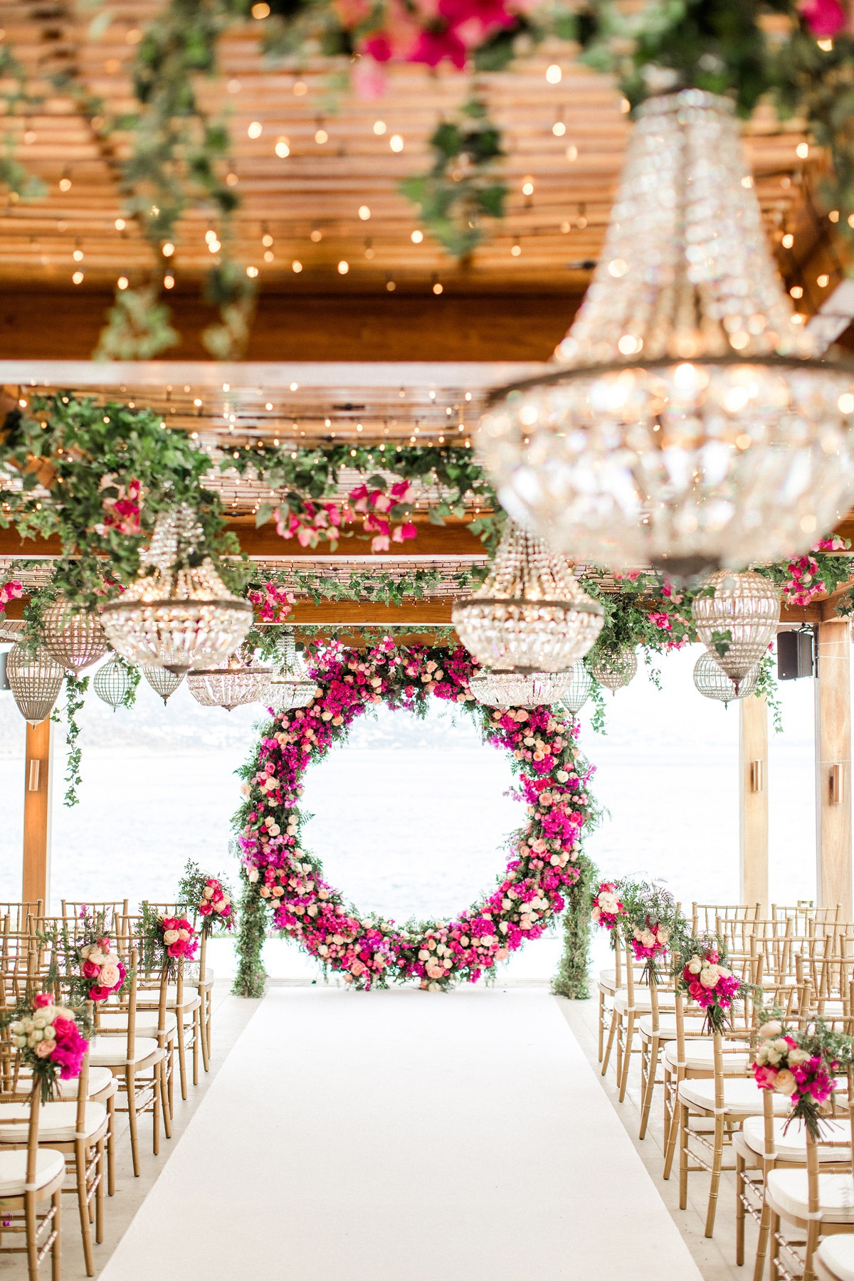 dramatic chandelier and floral wedding ceremony decor