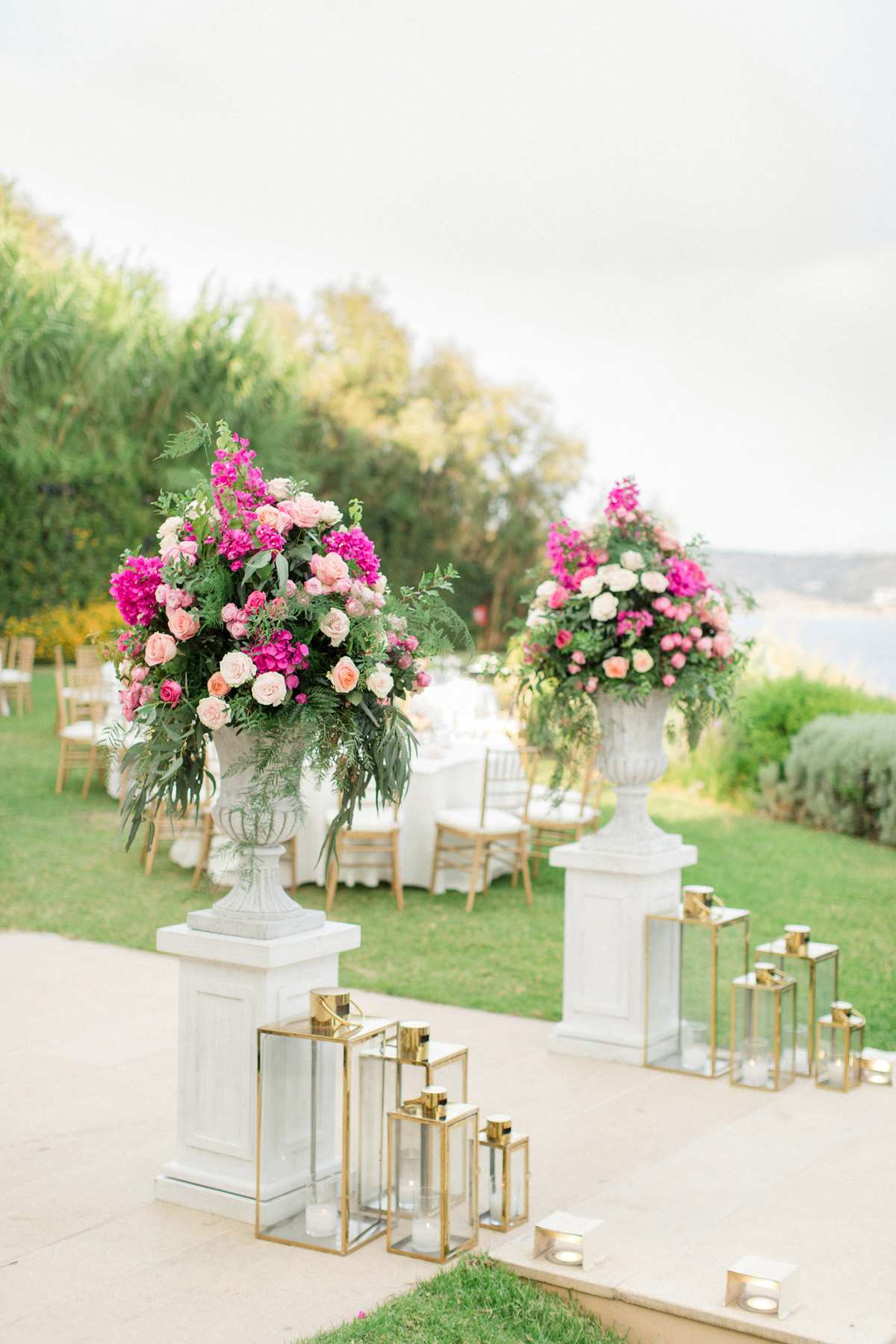 modern gold lantern and dramatic floral reception entrance
