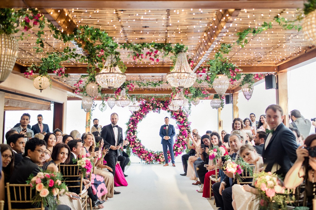 dramatic pink floral and fairy light wedding decor