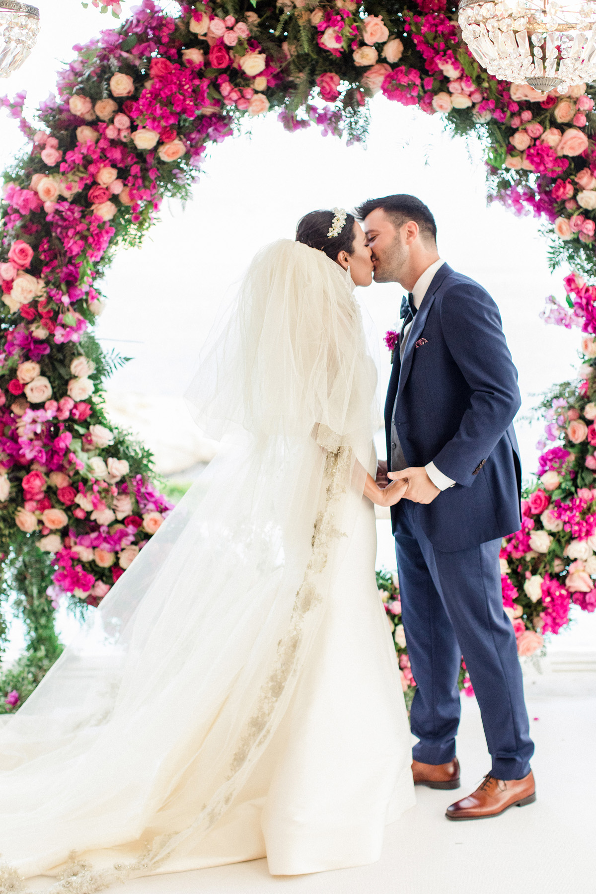 wedding kiss and pink giant wreath backdrop