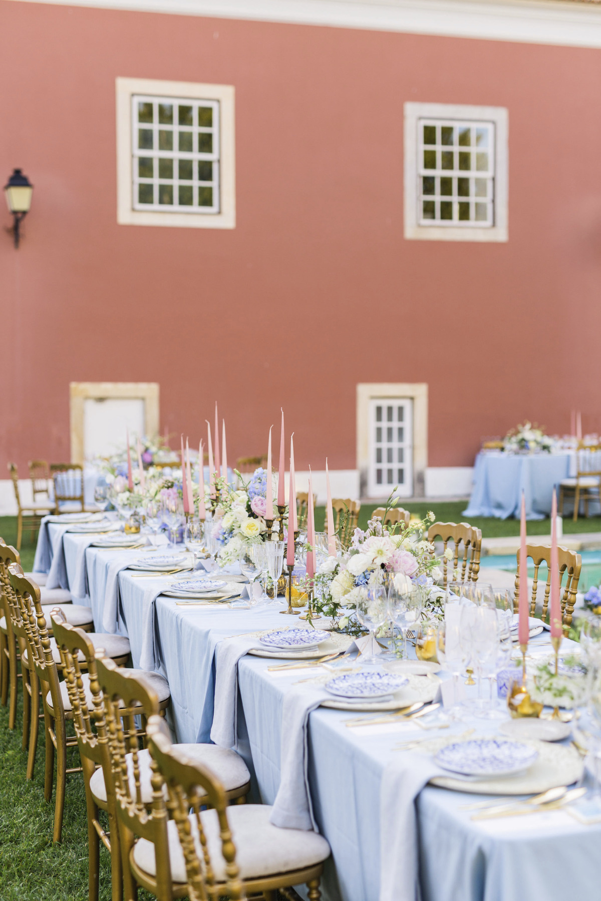 Blush, blue, and gold reception decor