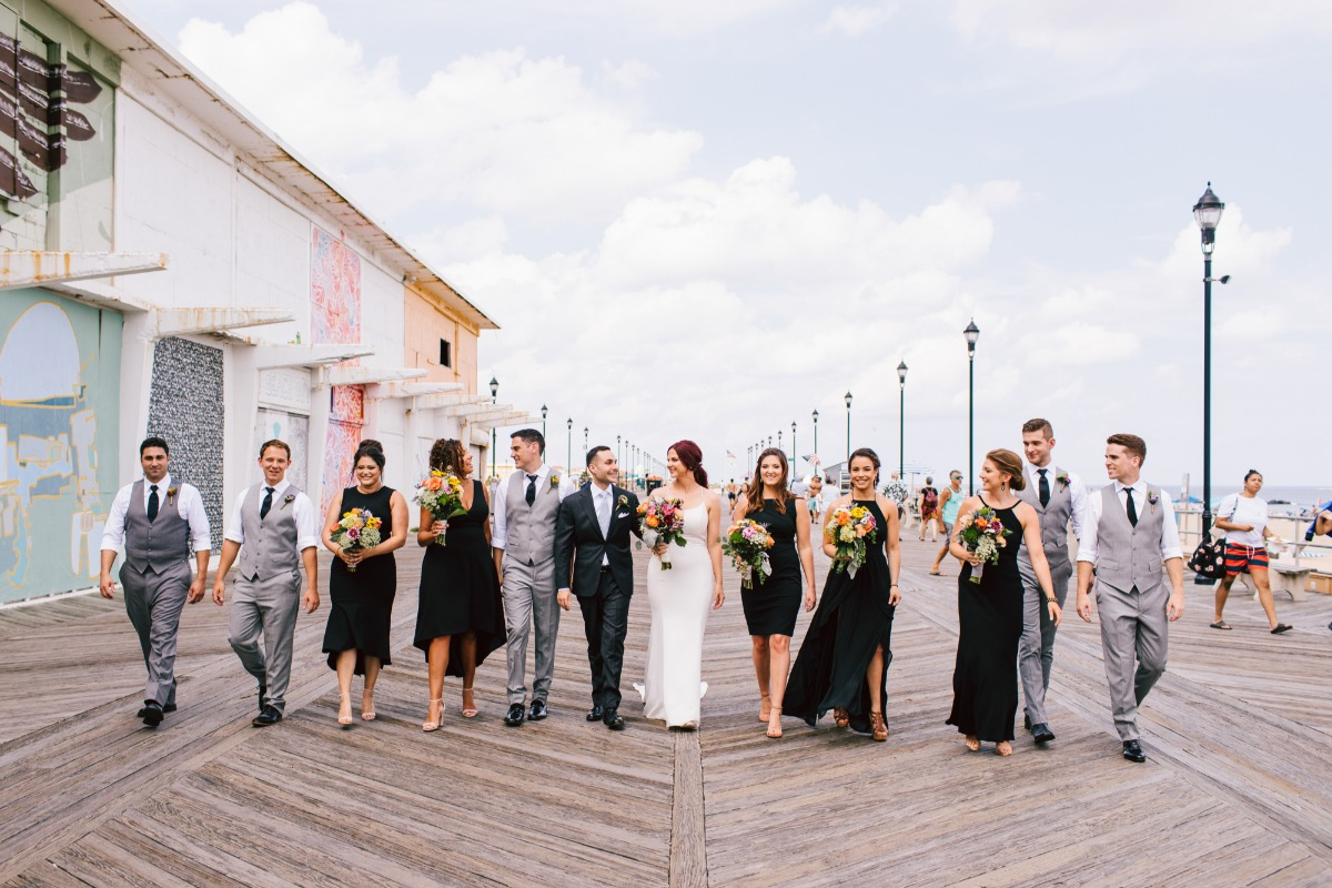 bridesmaids in black and groomsmen in grey