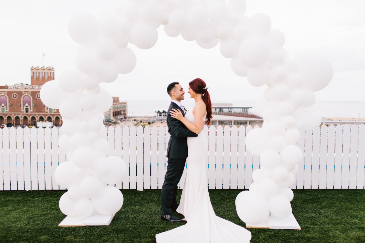 white balloon wedding arch