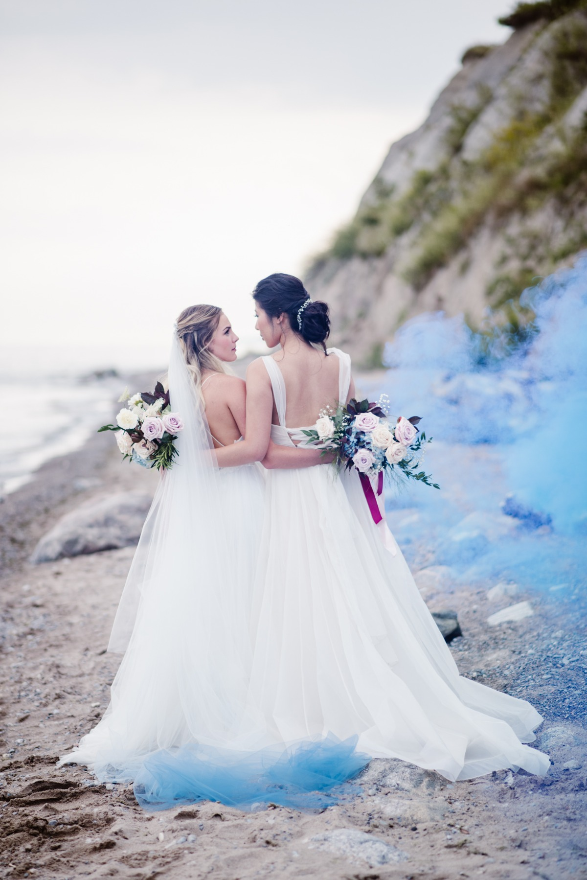 Blue smoke bomb beach wedding photo
