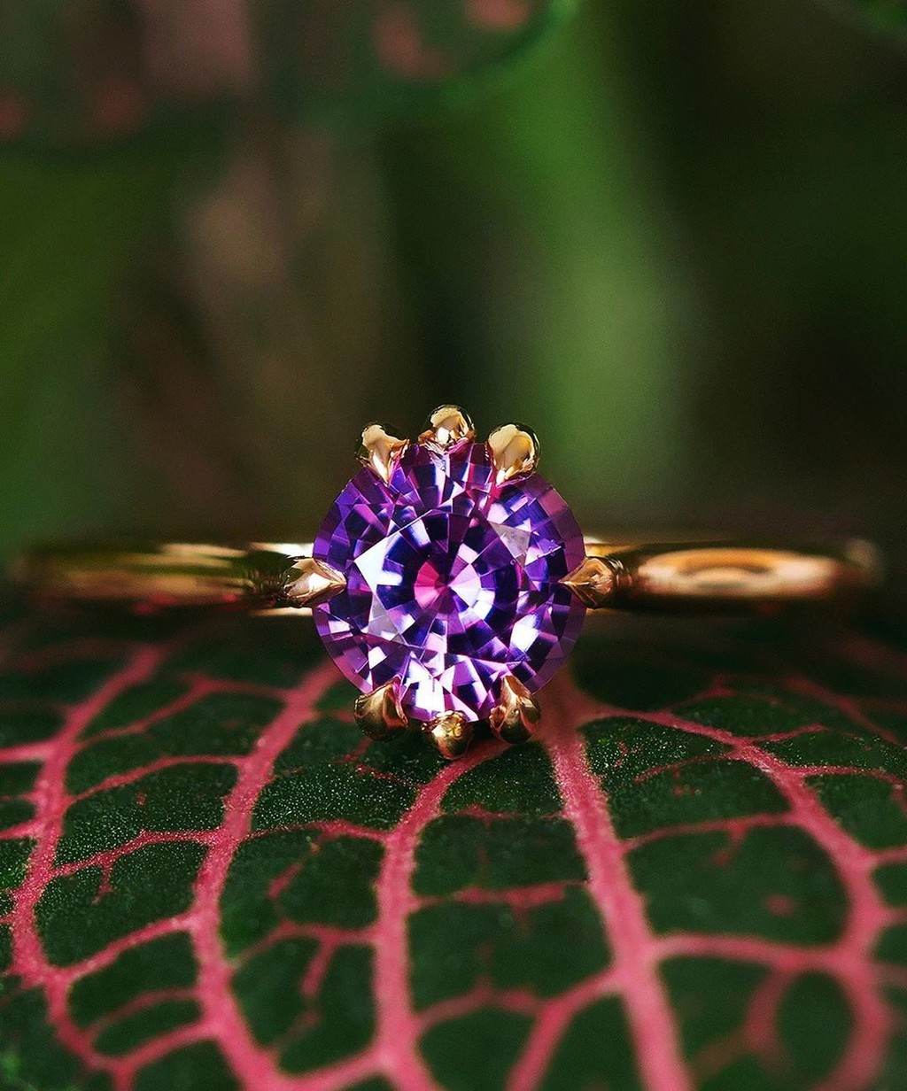 A Masterfully Cut 1.01ct Pink & Purple Sapphire sits minimally in our hand crafted recycled 18k gold Zoe Ring. Link in bio up online