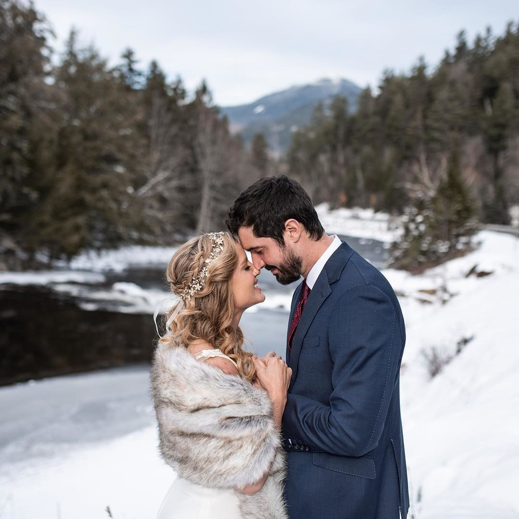 Stunning bride Amber with her handsome groom in a perfect snowy setting. Amber is wearing the Violetta Hair Vine, a lovely boho chic