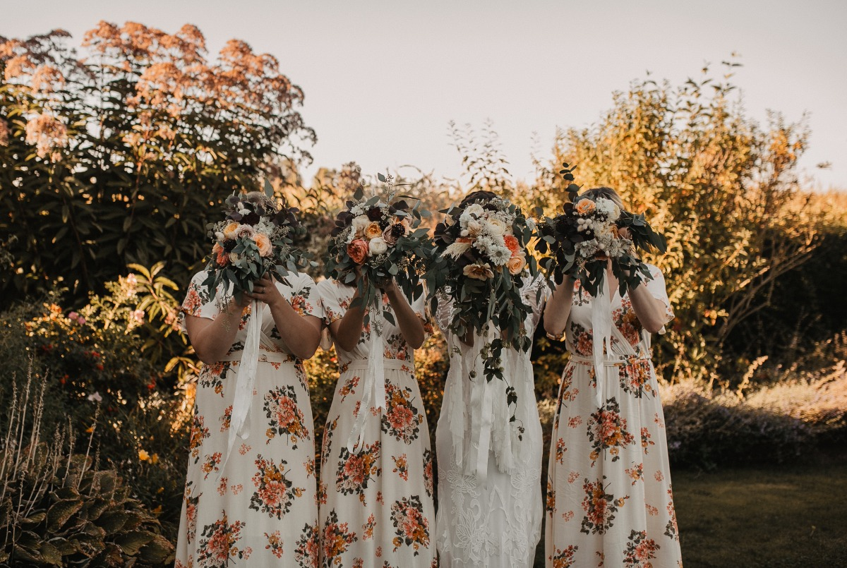 bridesmaids in fun floral dresses