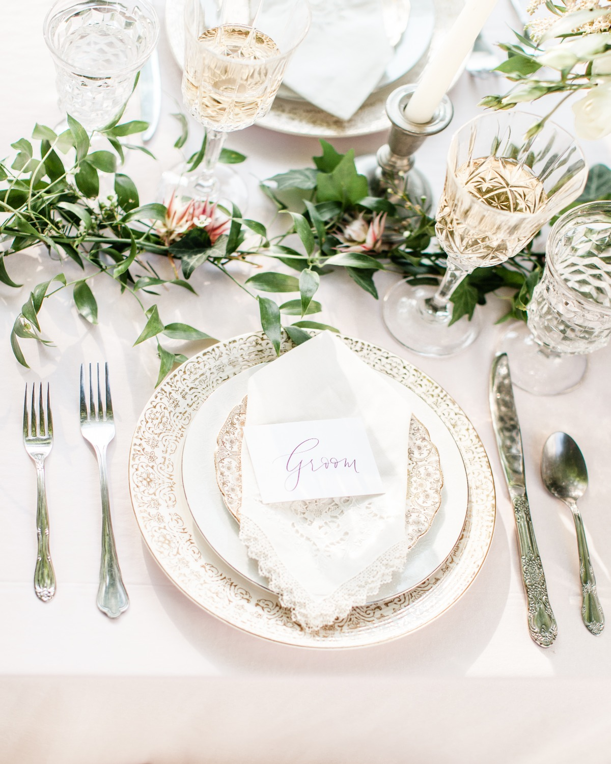 white and gold accented wedding place setting