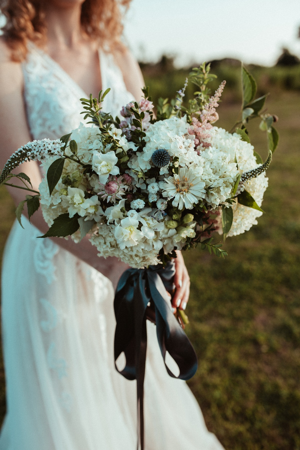 Elegant wedding bouquet with black ribbon