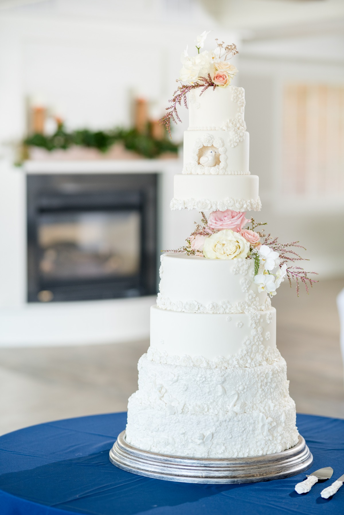 all white wedding cake with flower accents