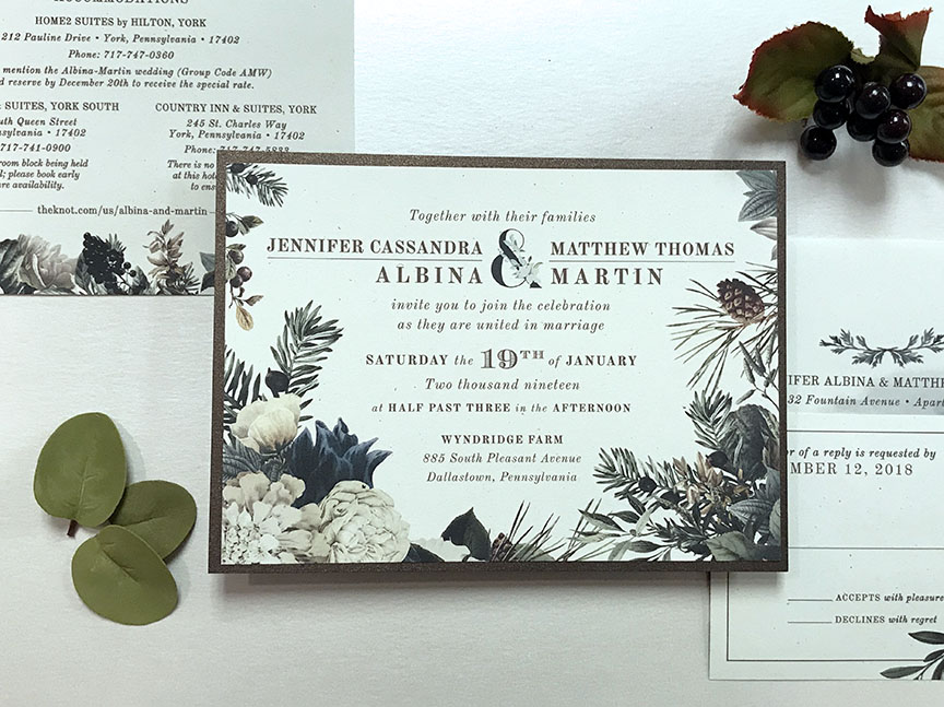 Some gorgeous woodland florals this lovely winter wedding invitation designed by Persnickety Invitation Studio.
