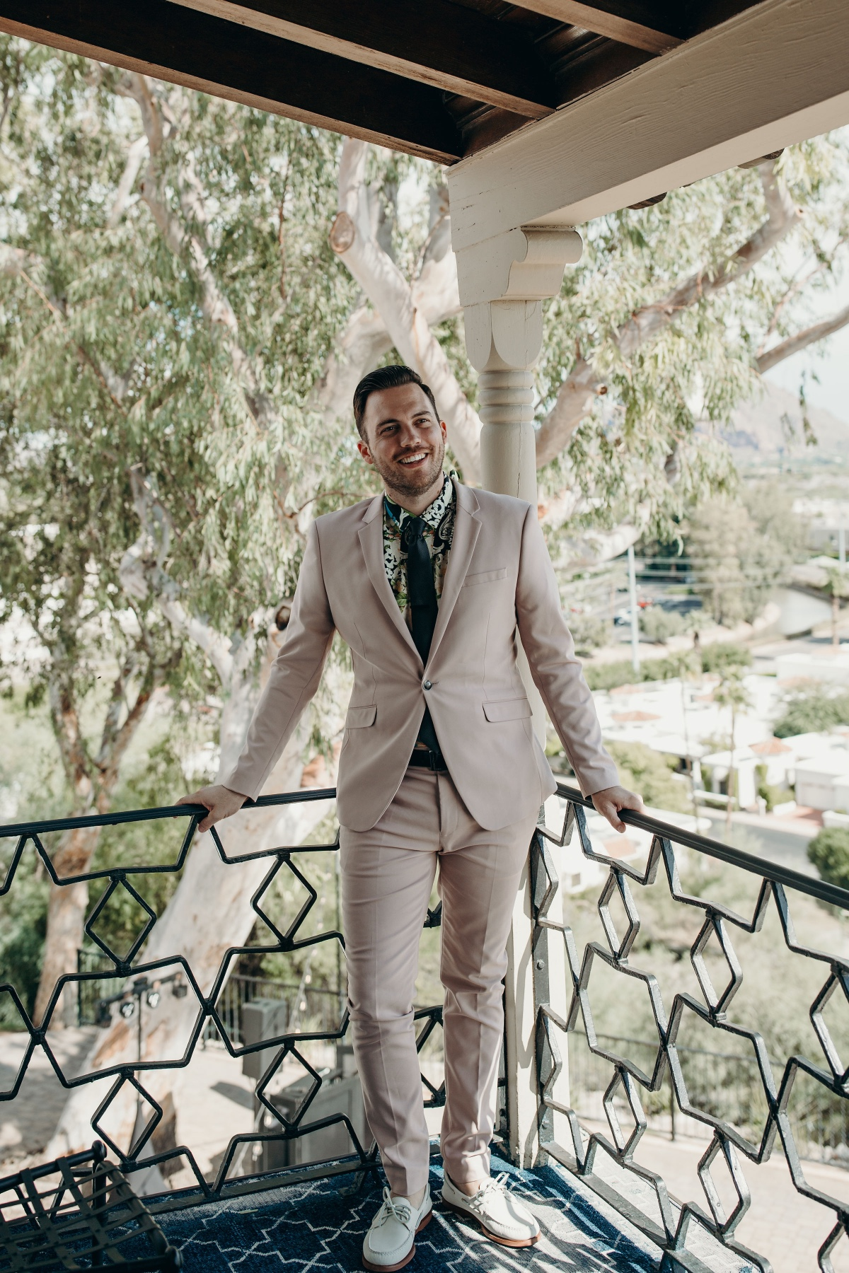 Pale blush suit for the groom