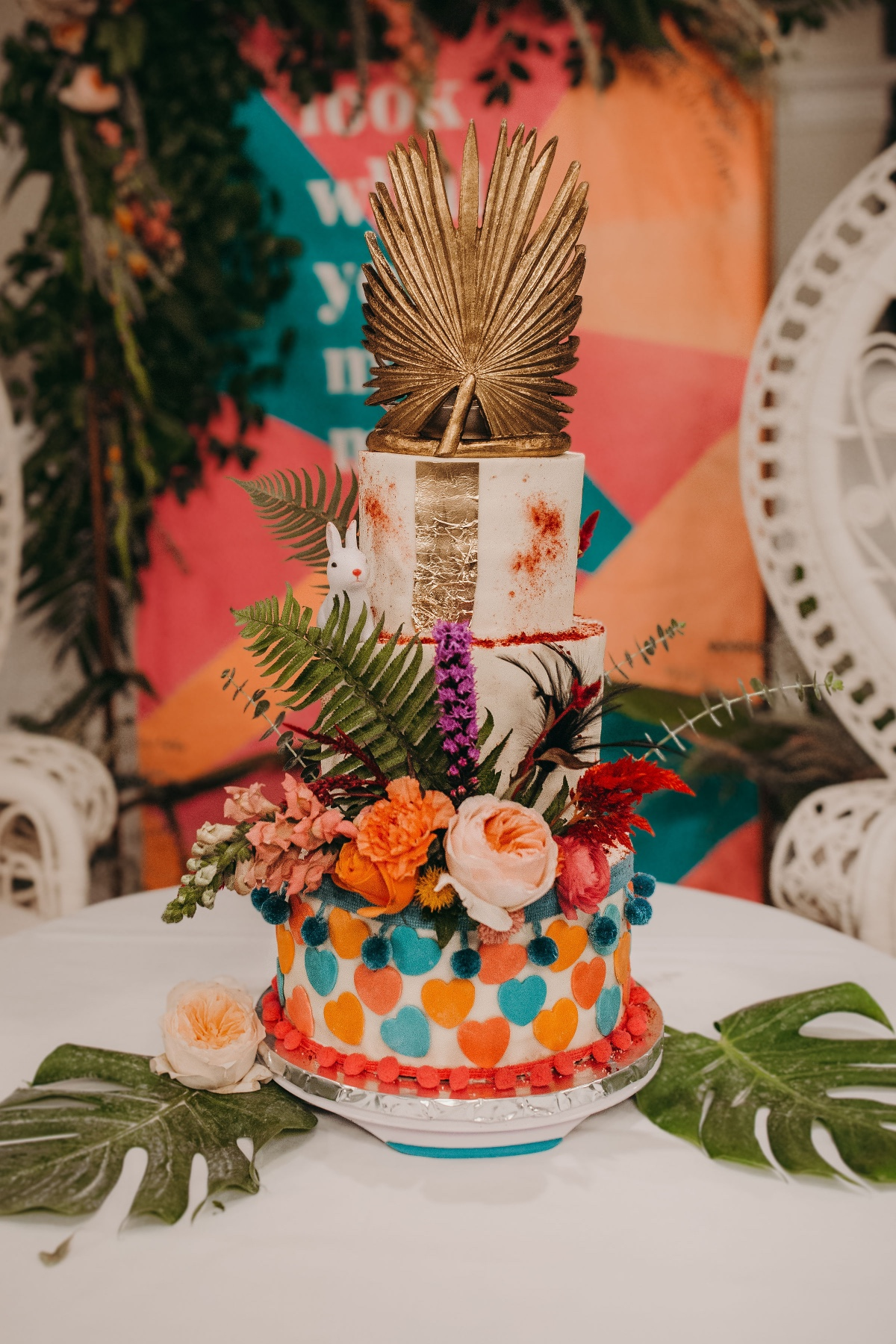 Eclectic Alice in Wonderland inspired wedding cake design