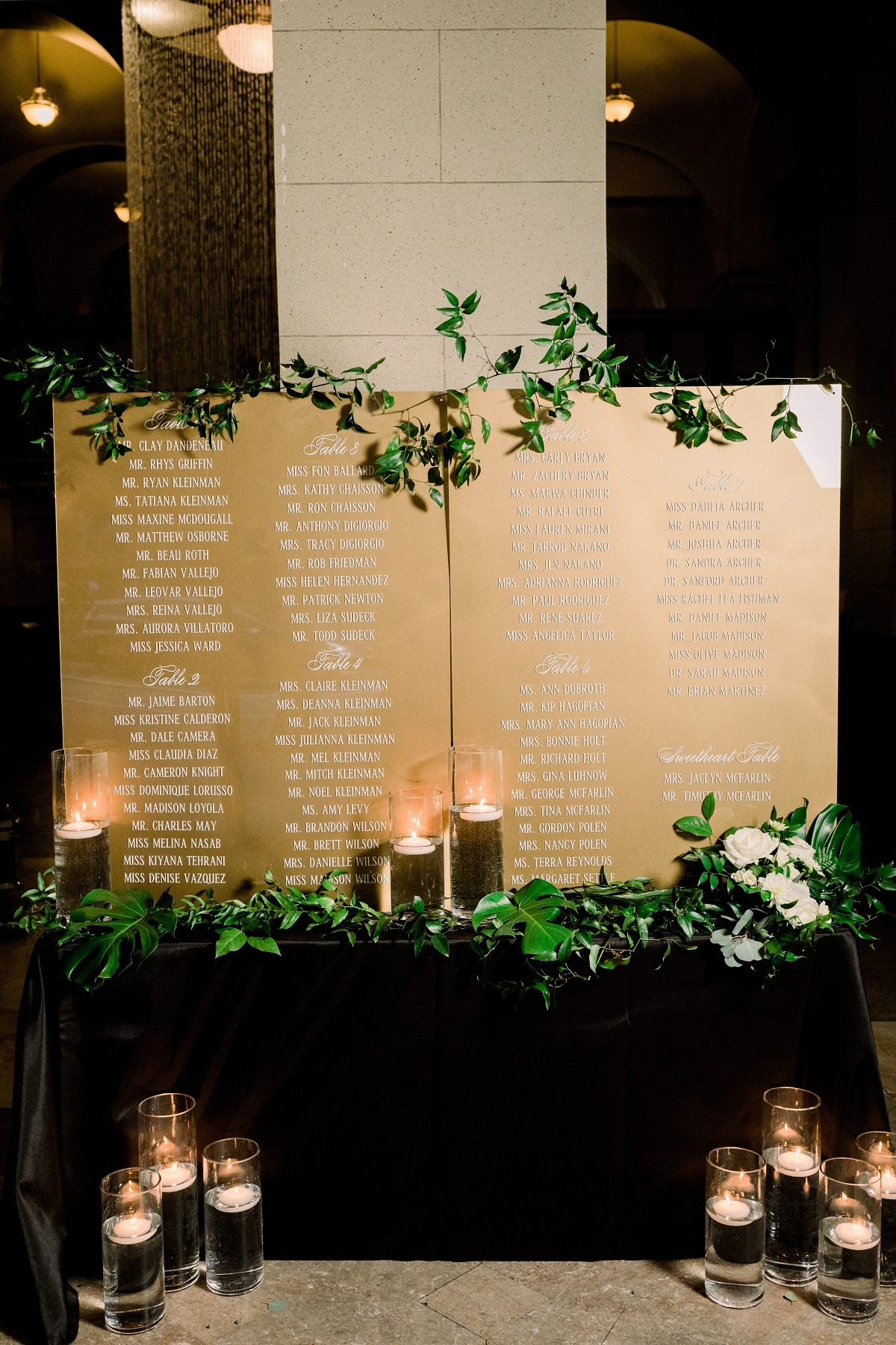 Gold seating chart with greenery