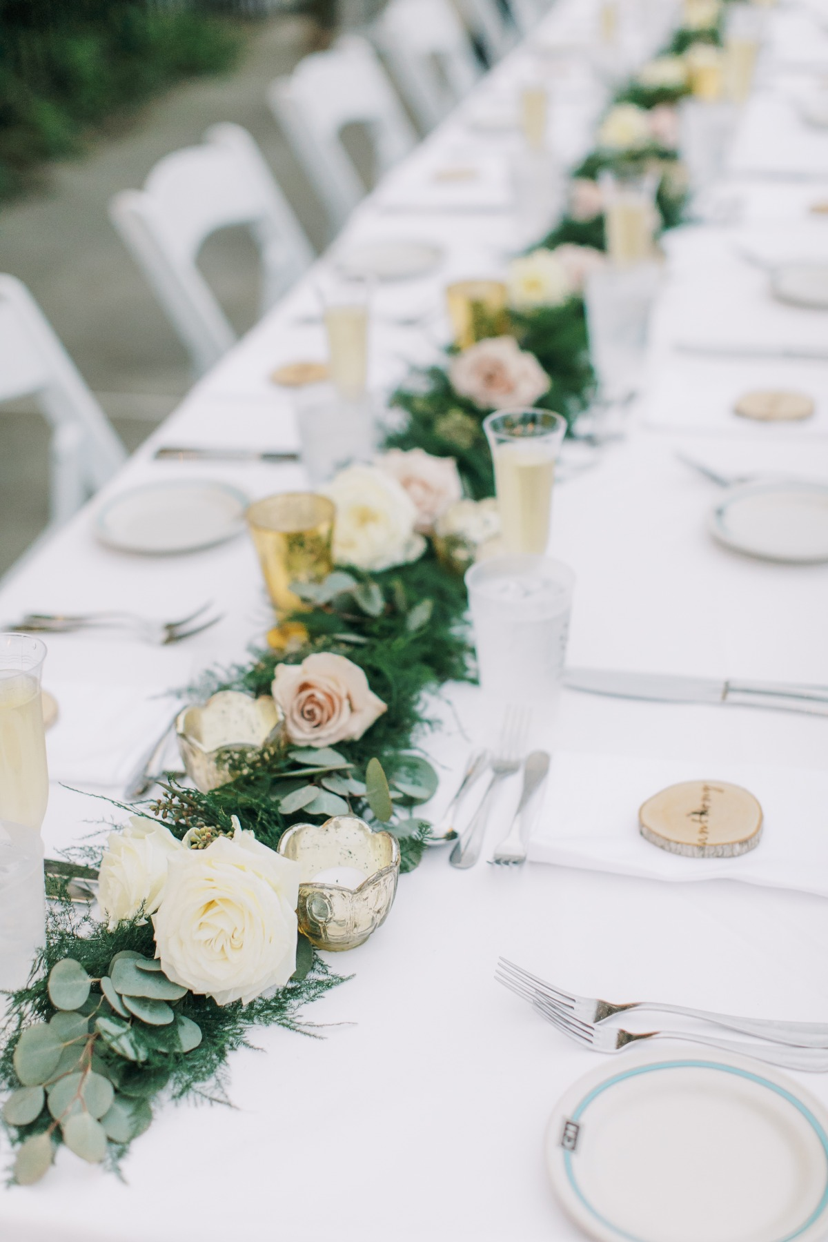 Greenery and rose centerpiece