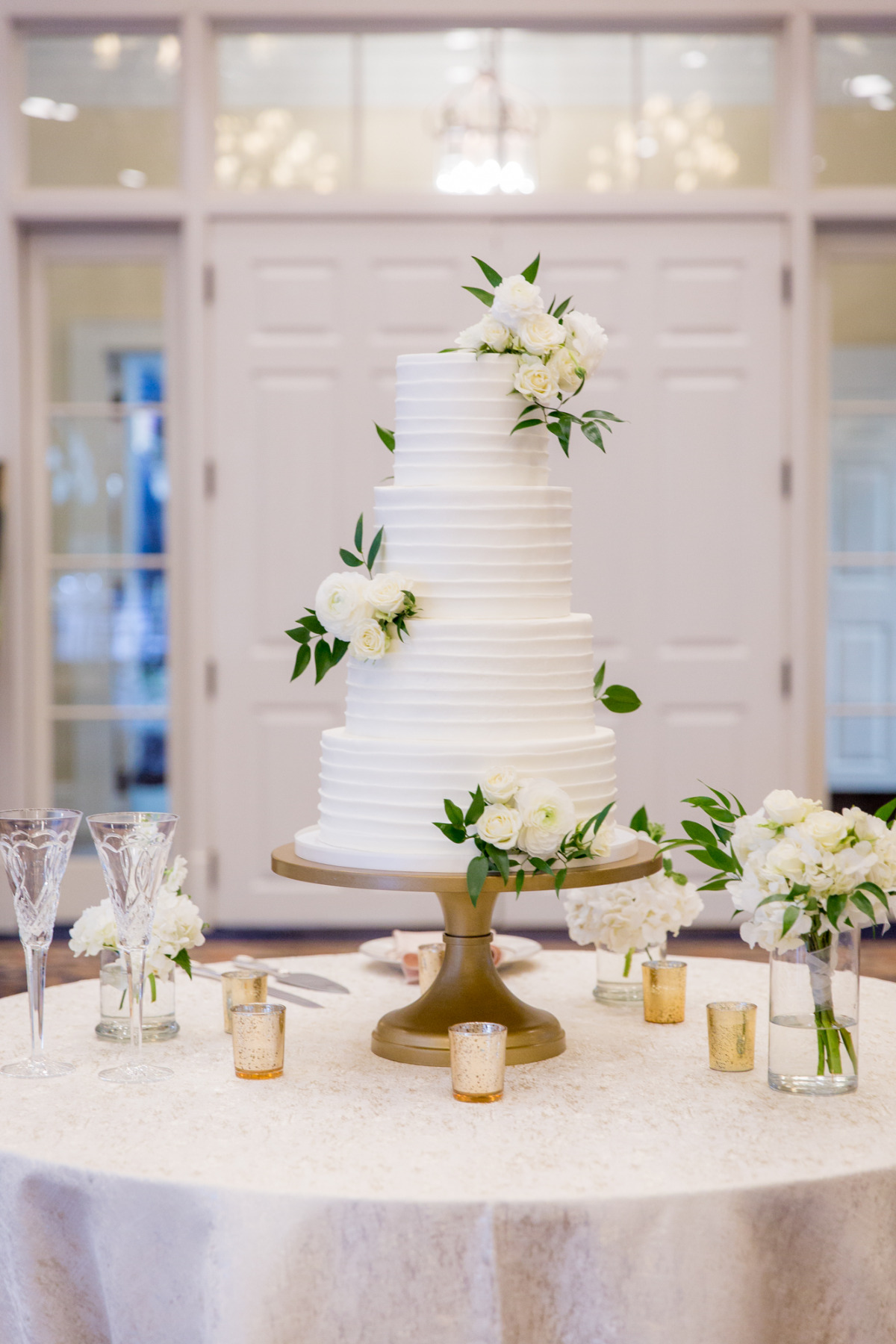 4 tier white wedding cake