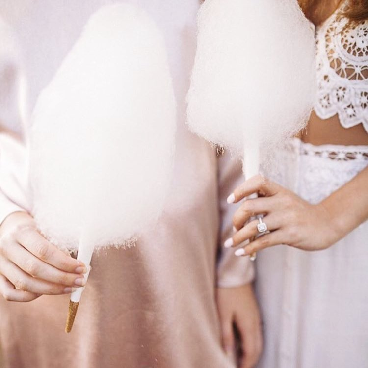 Bride and bridesmaid holding cotton candy