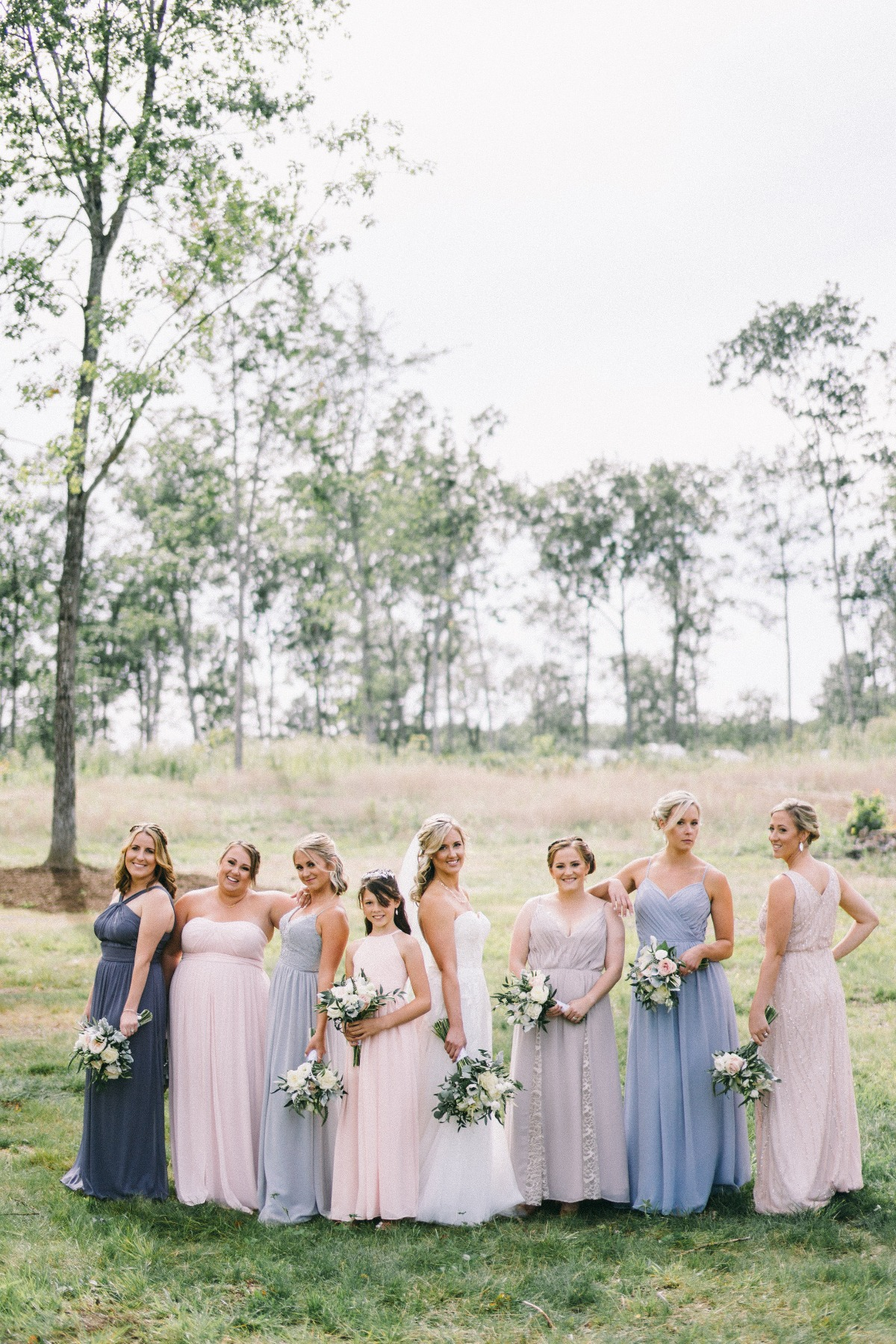 Mismatched bridesmaid dresses for a farm wedding