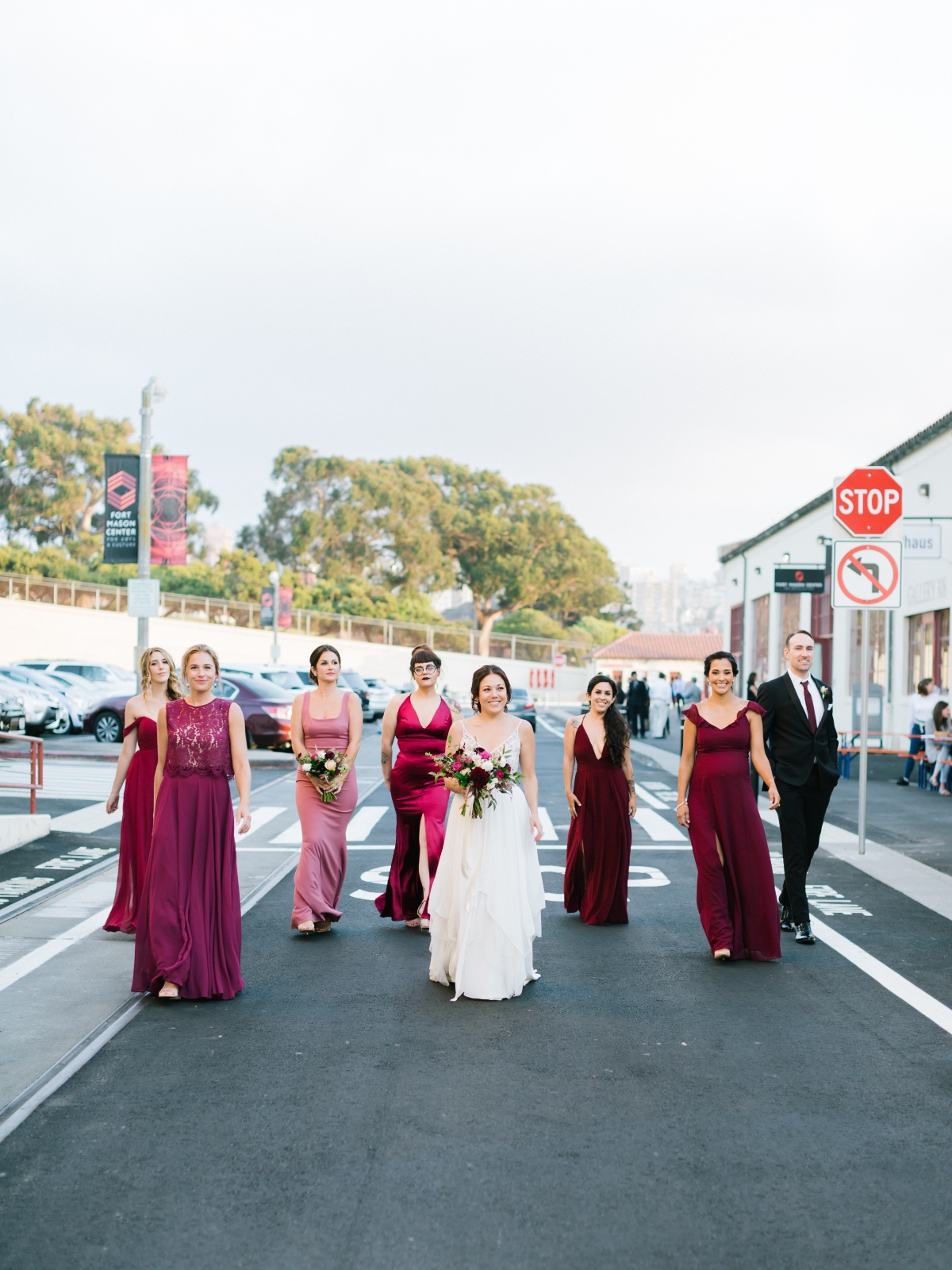 Bridesmaids in pink and burgundy
