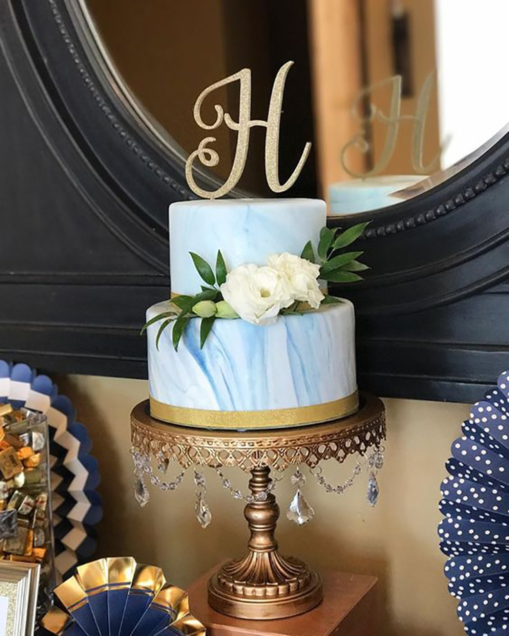 Modern Blue Marble Wedding Cake on Antique Gold Chandelier Cake Stand. Opulent Treasures offers a gorgeous collection of wedding cake