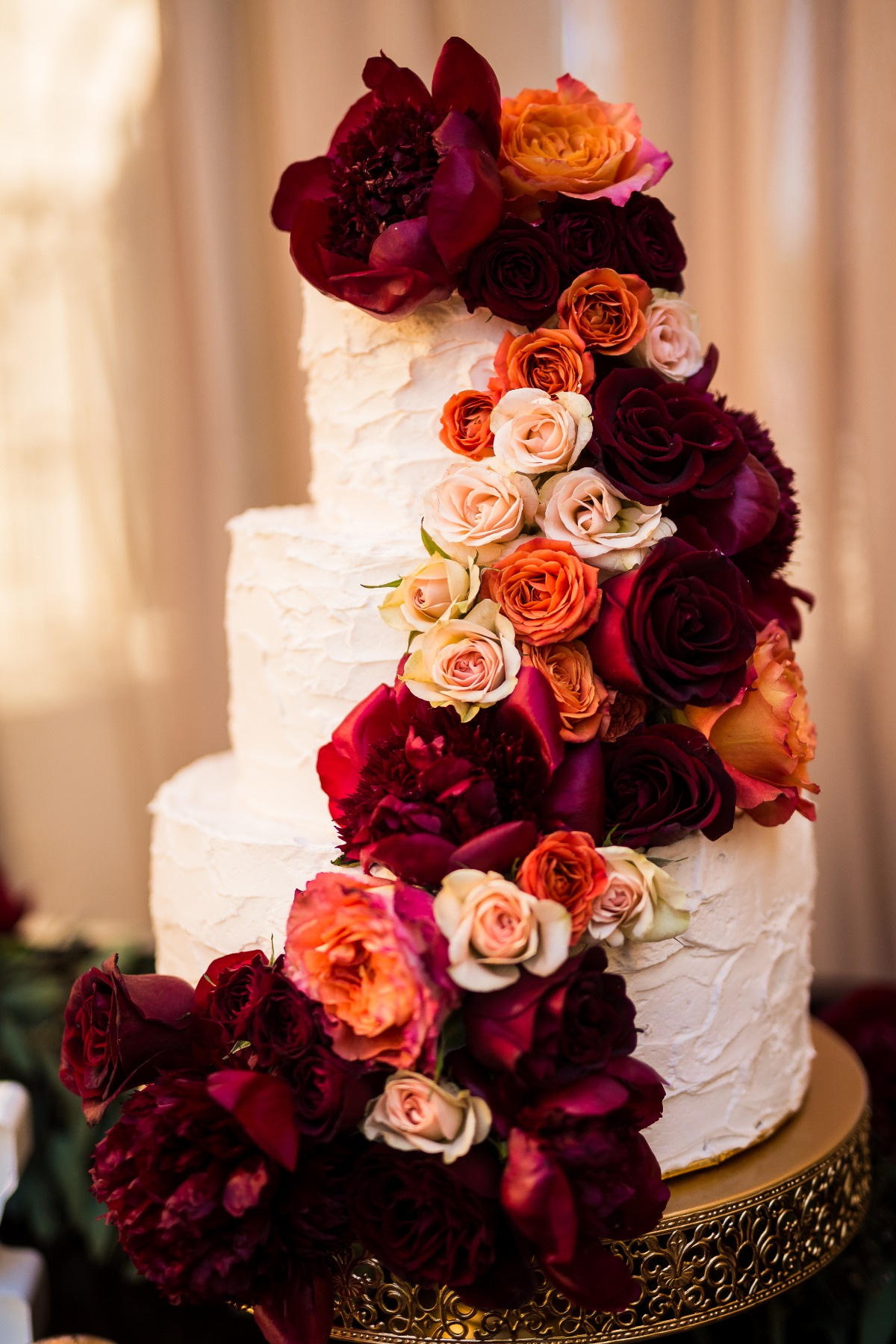 Wedding cake covered in roses
