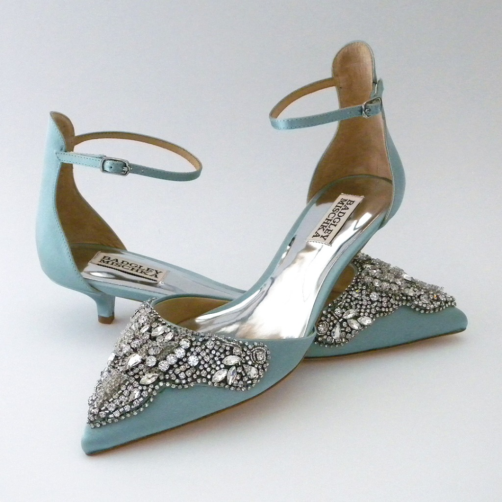 A kitten heel that truly dazzels! Sexy high back with adjustable ankle strap, closed toe with sparkling applique . Comfort never