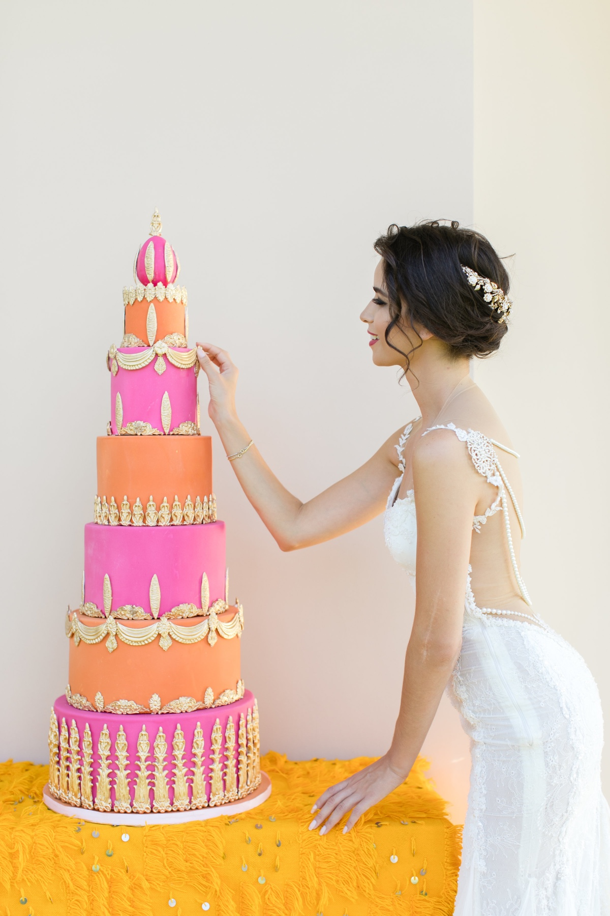 pink orange and gold wedding cake idea