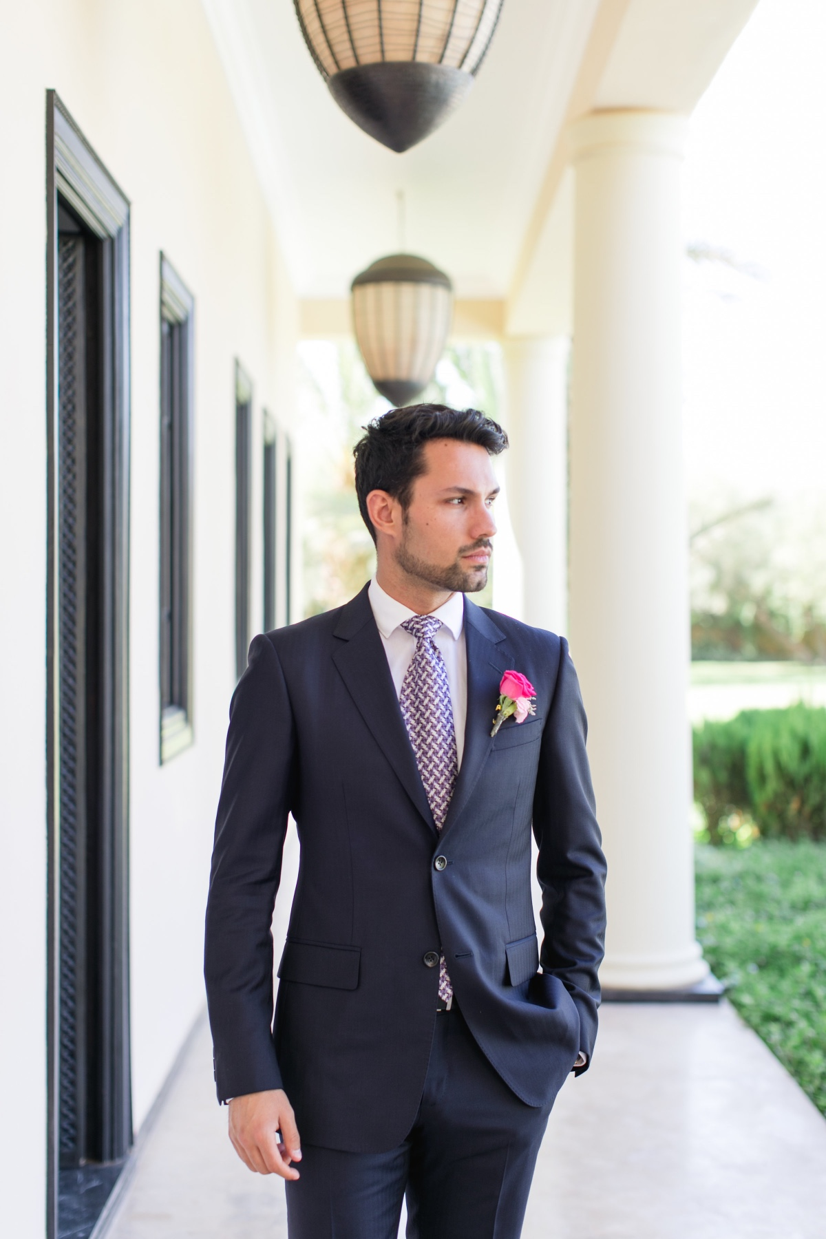 groom in navy suit and patterned tie