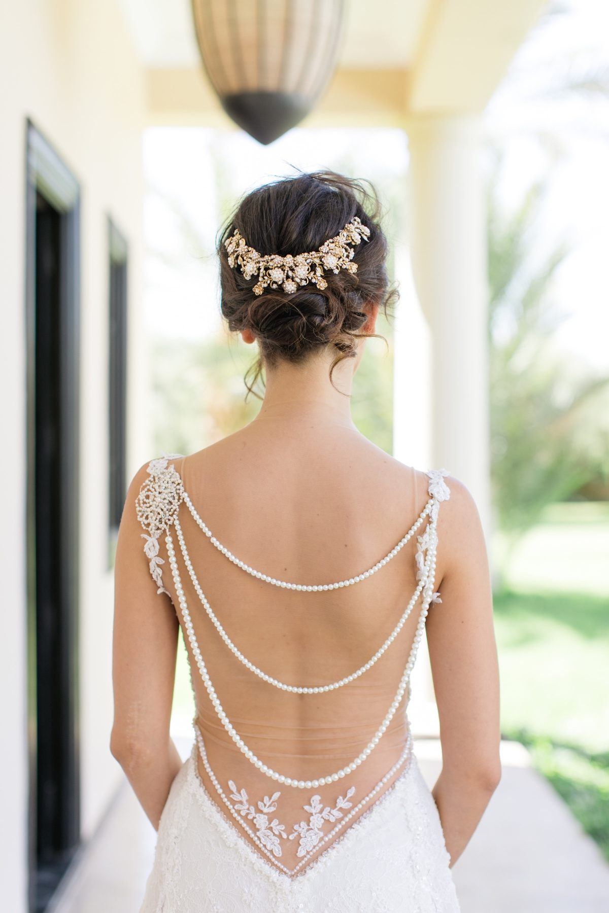 romantic wedding dress with pearl draped back