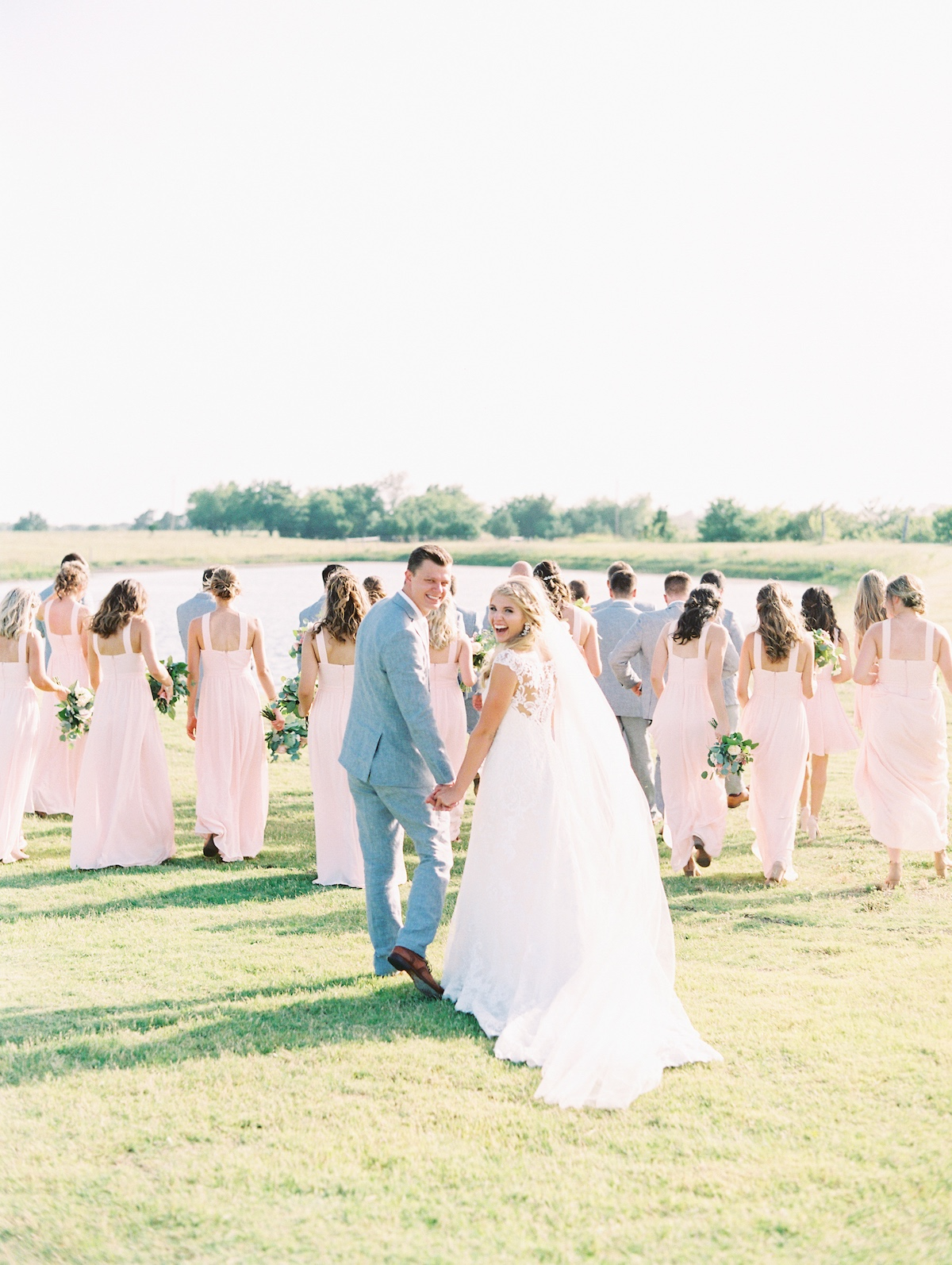 a wedding party in soft grey and blush