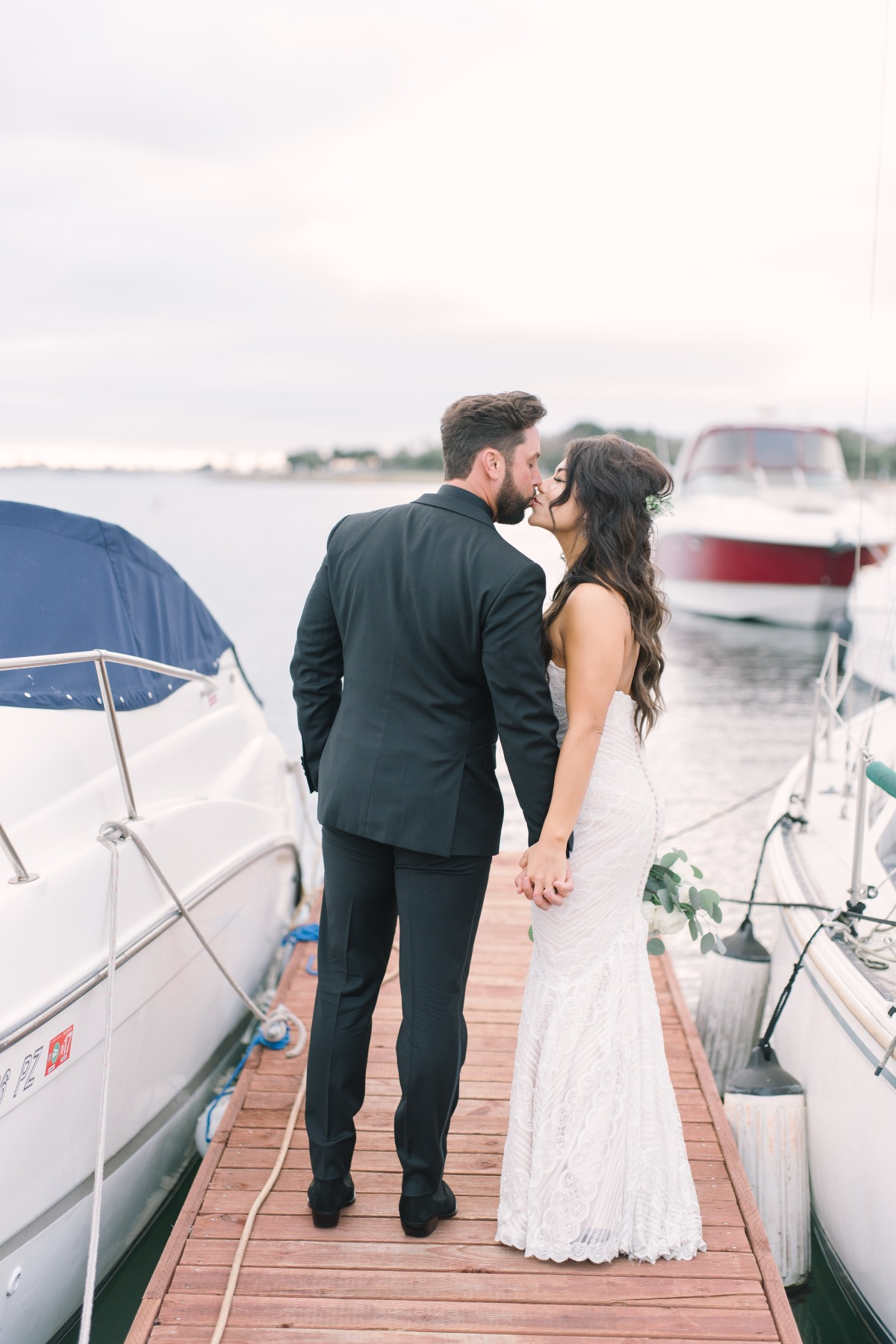 wedding kiss by the bay