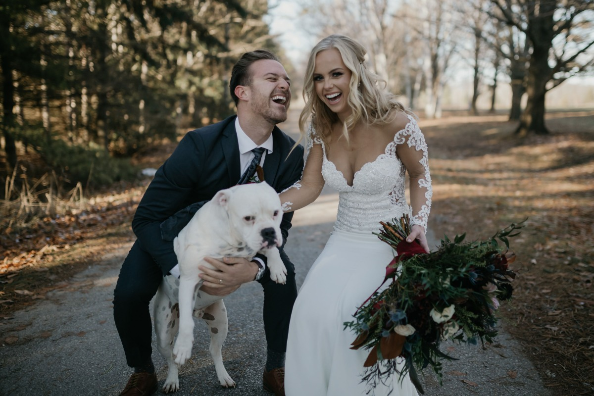 bride and groom and their pup