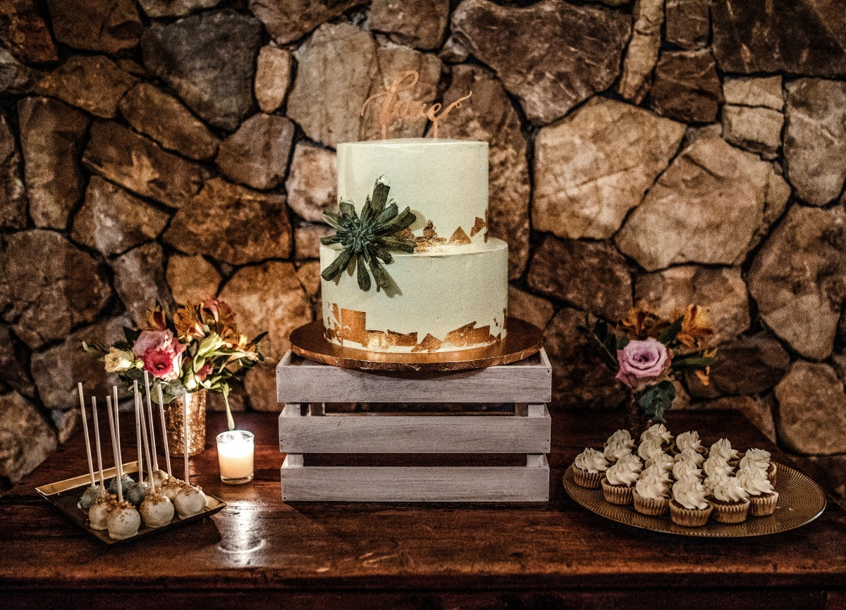 gold leaf and white wedding cake