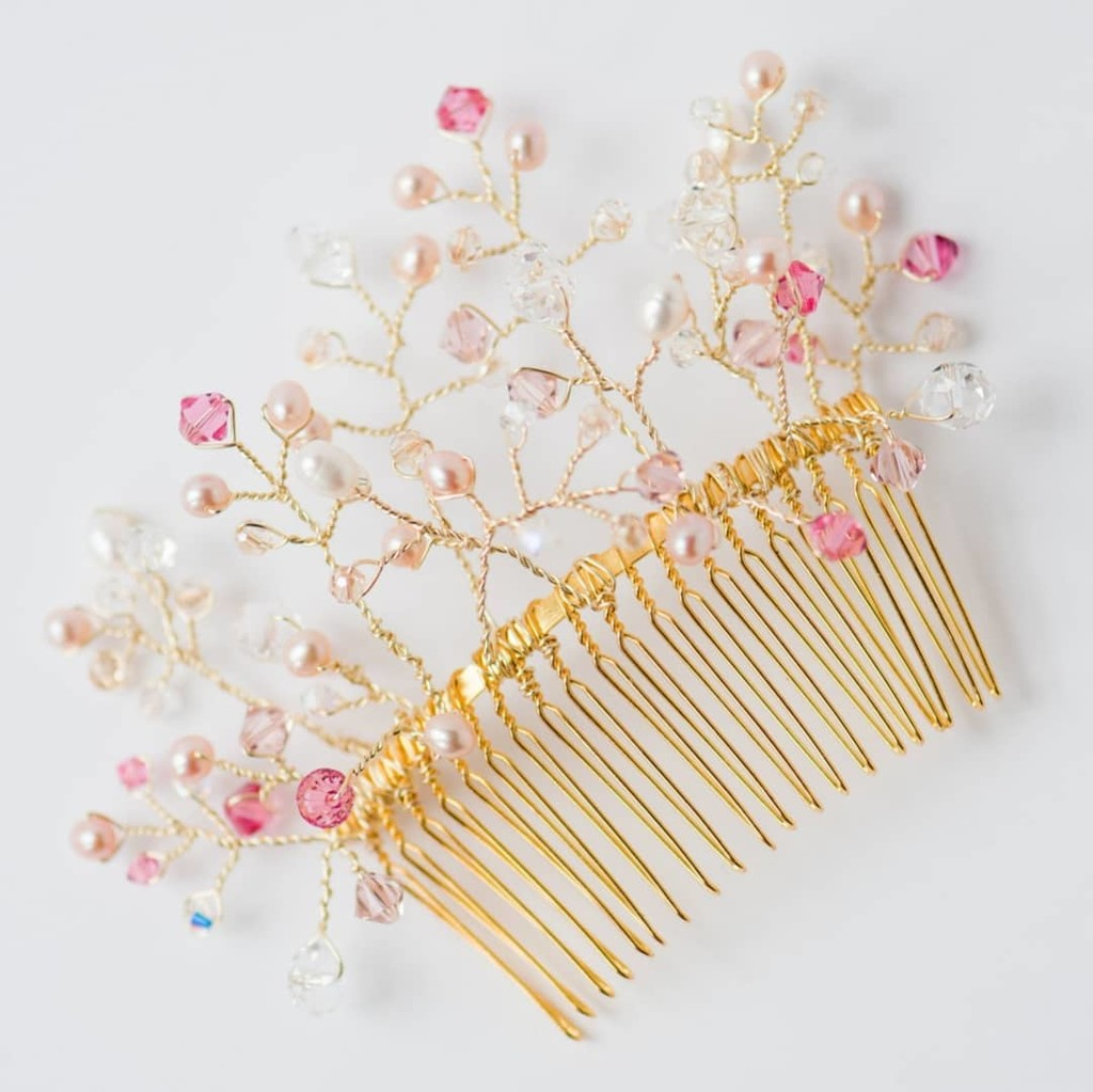 The flexible branches of freshwater pearls and Swarovski crystals in our Pink Confetti Bridal Comb can be woven into any hairstyle
