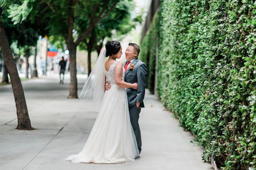 We love the urban look and feel we're getting in this photo from this living green wall backdrop that was picture perfect for our couple