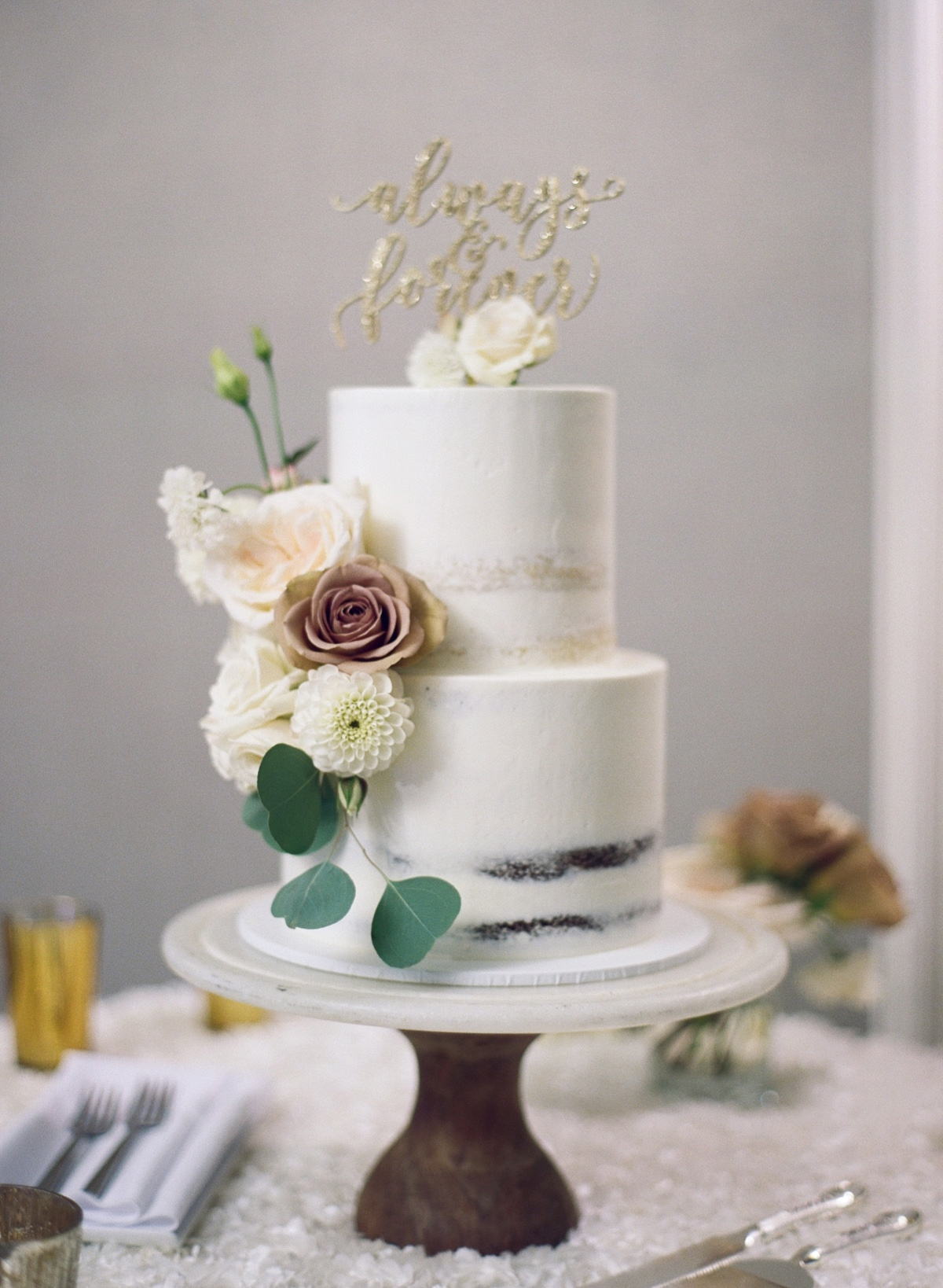modern flower accented wedding cake