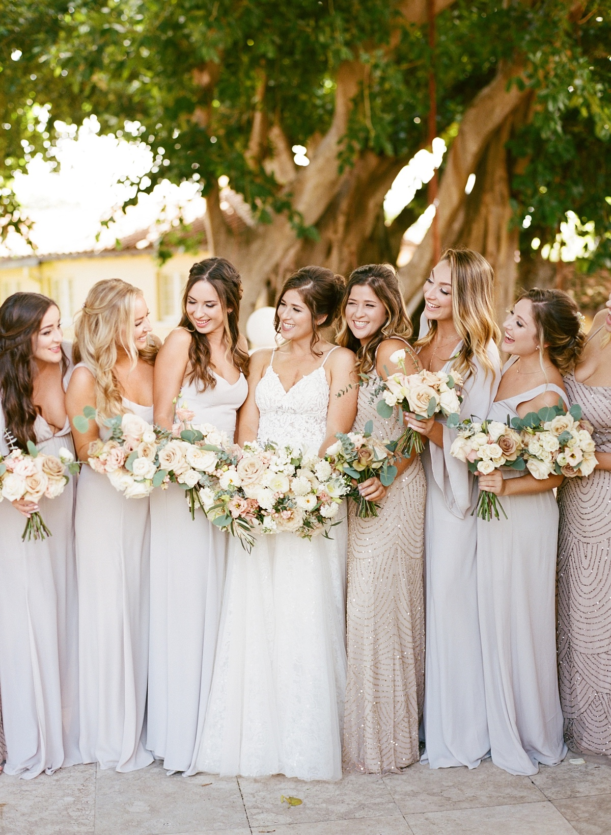 bridesmaids in soft grey and champagne