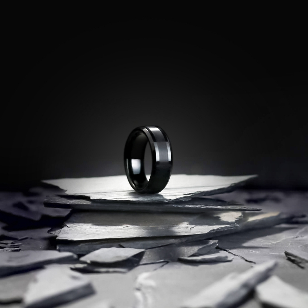 Mens black tungsten wedding ring with a brushed textured center. Check out our Black Wedding Ring Collection!