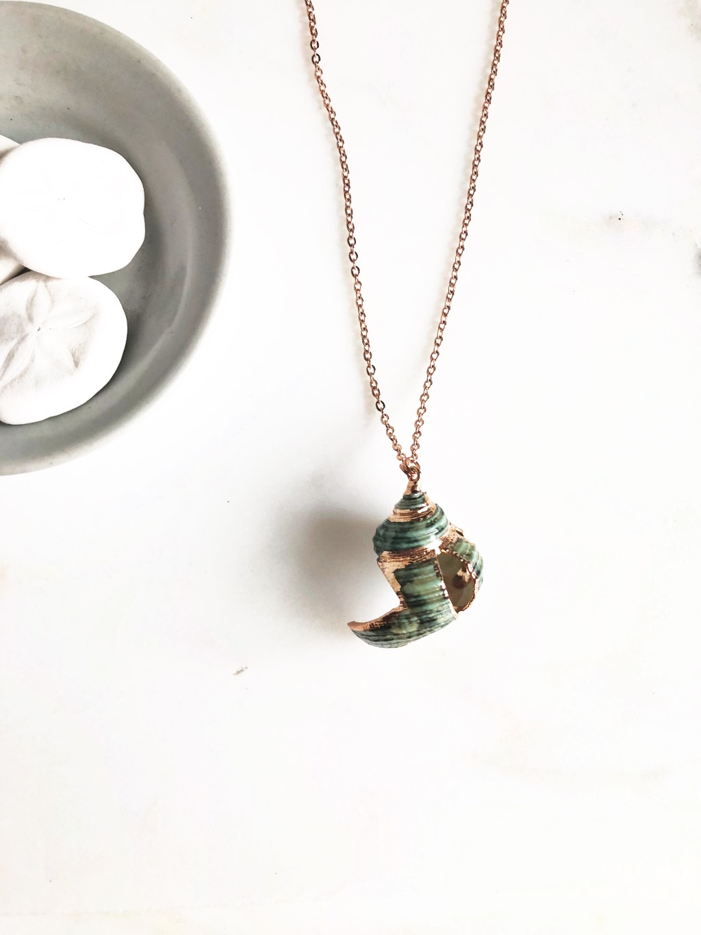 Gorgeous green seashell necklace with rose gold accents, perfect for a beach inspired wedding!