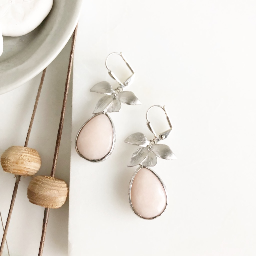 Gorgeous and classic silver orchid earrings with sweet soft peach stones.
