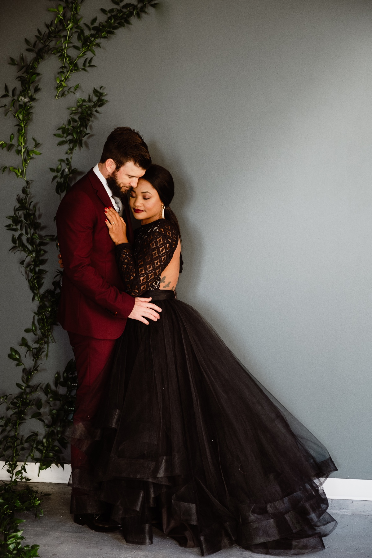 wedding couple in black and burgundy