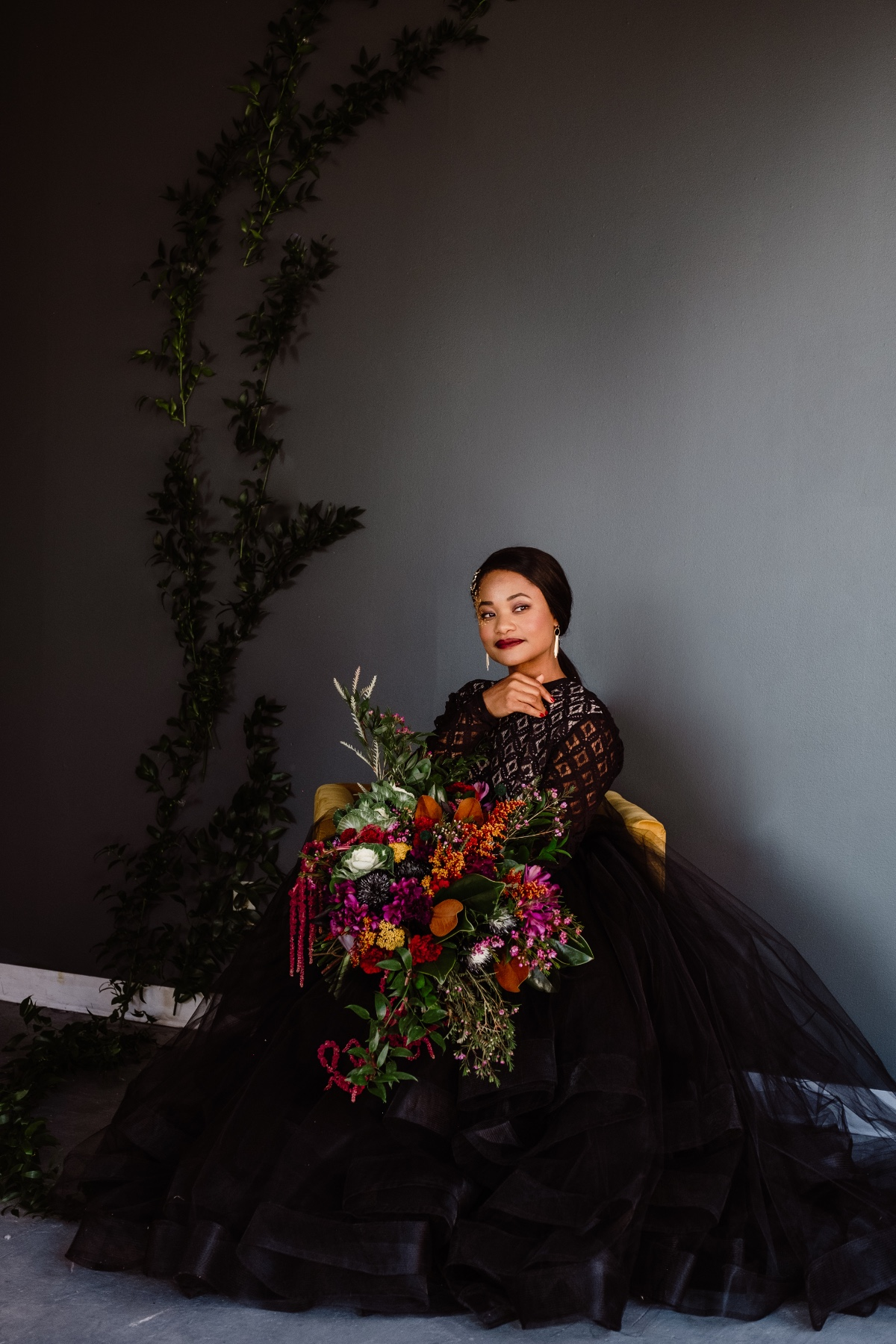 bride in black with modern colorful bouquet