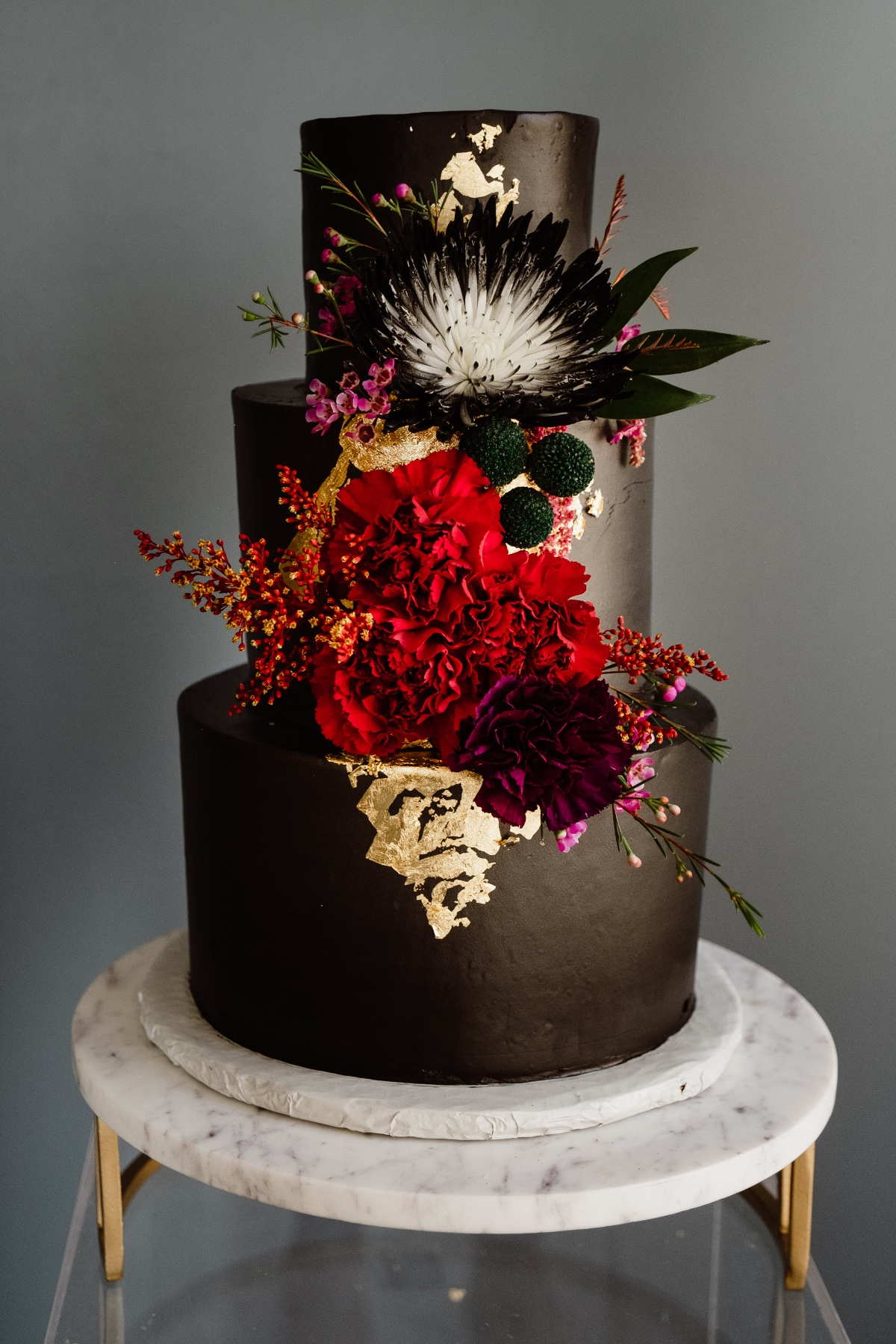 black cake with modern floral decor