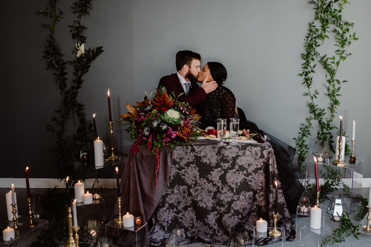 dark and moody wedding sweetheart table