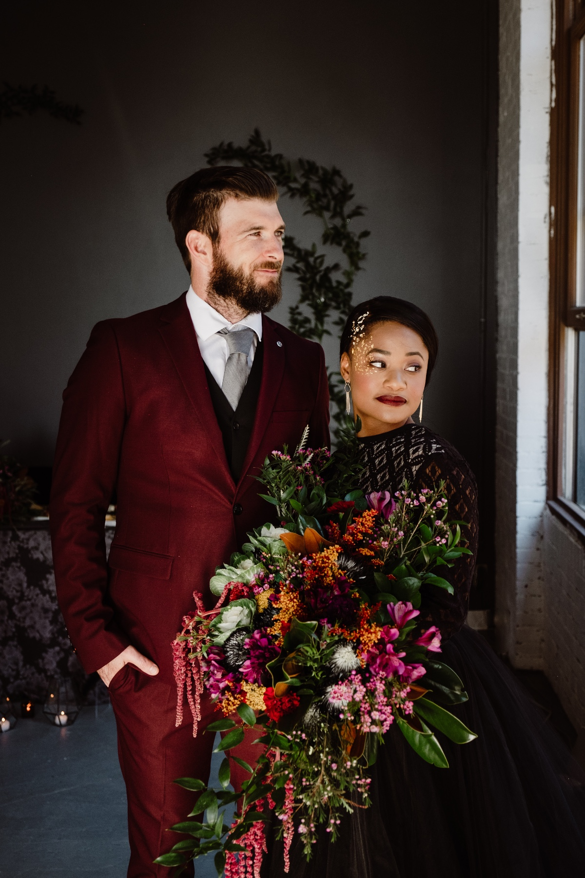 deep and moody wedding couple style