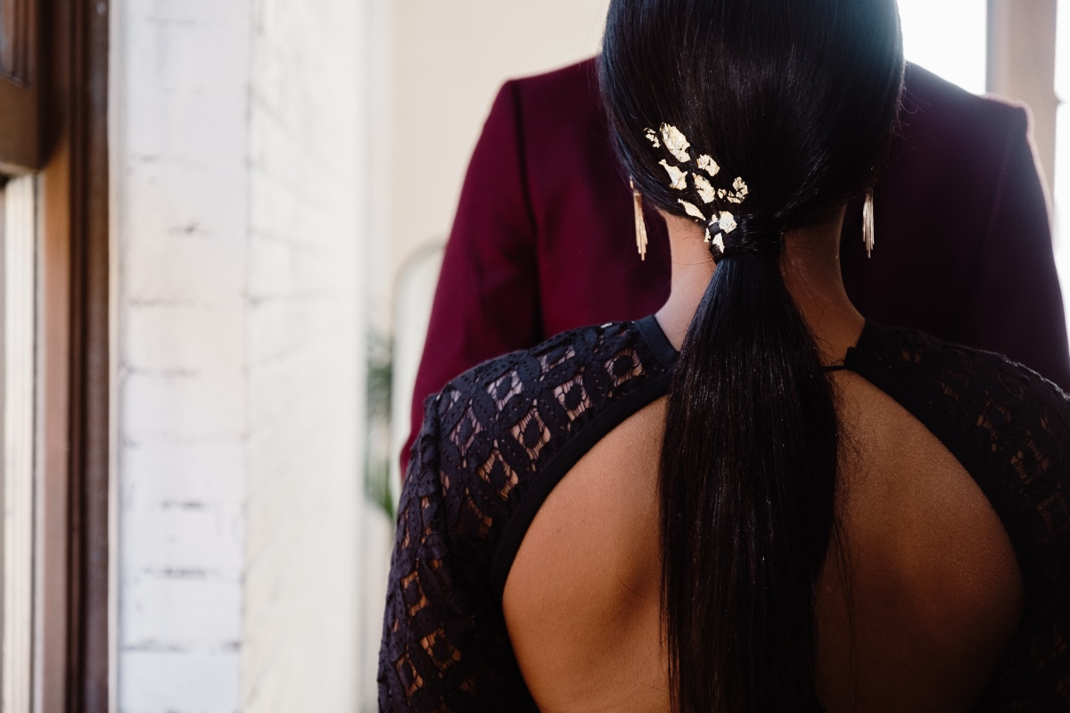 sleek low ponytail with gold leaf accents