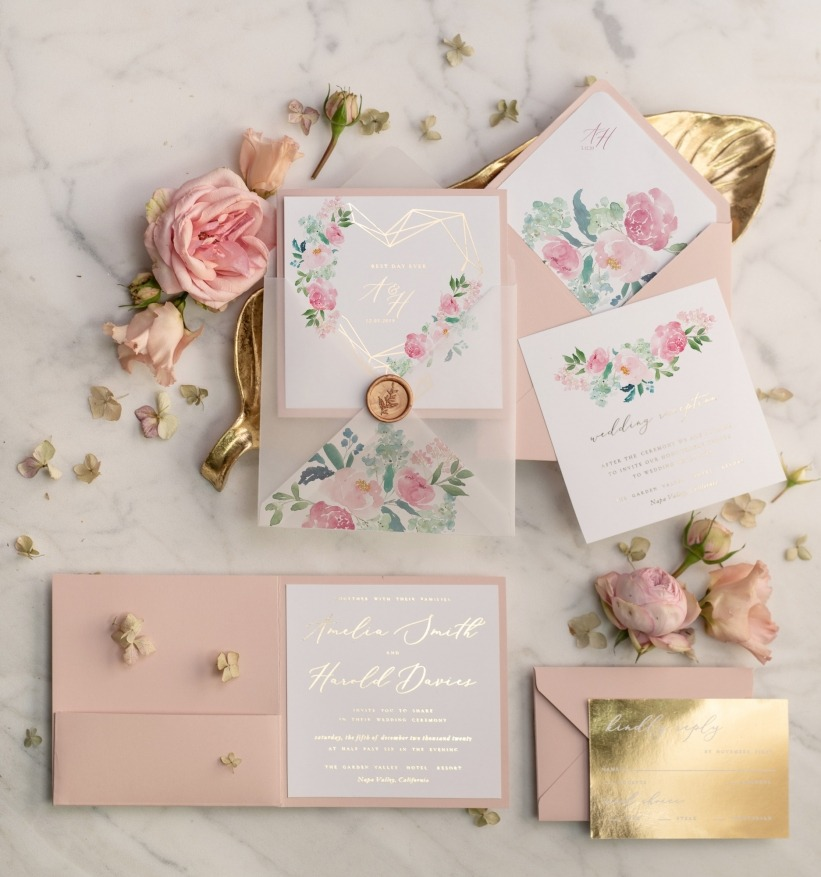 Pastel pink weding invitations with gold