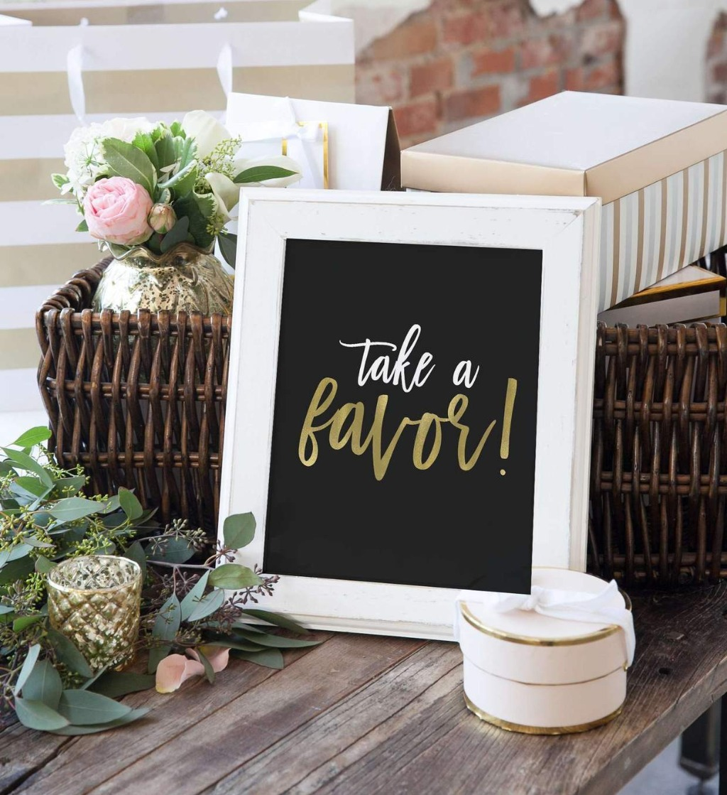 We're big fans of little signs to sit around your wedding reception that serve a purpose! This Take a Favor Sign Wedding Sign from