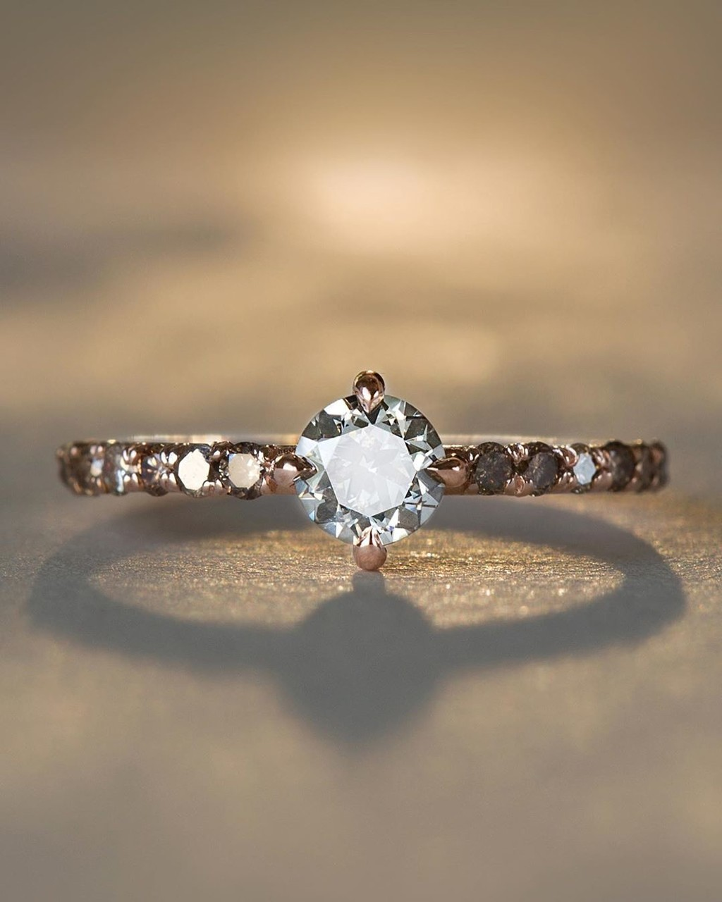 Funky, Sweet, & Unique describe this simply glowing diamond studded solitaire. A center transitional brilliant post-consumer Diamond