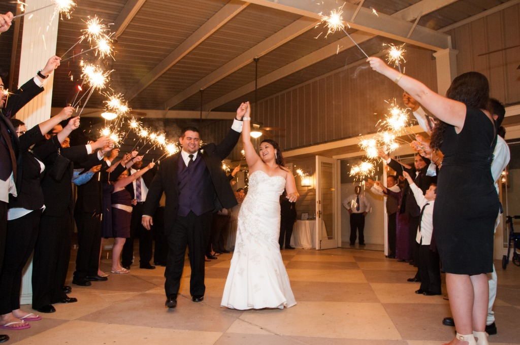 Lighting sparklers at your wedding can be quick and easy if you plan ahead and follow these suggestions listed below. You do want to